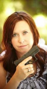Amanda Collins holding gun