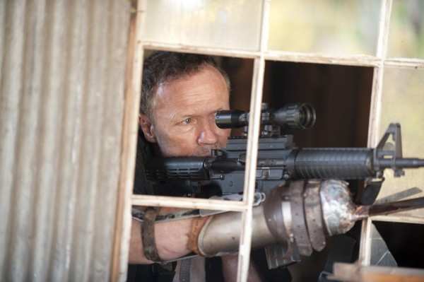 the-walking-dead-michael-rooker-season-3 with gun takes aim photo