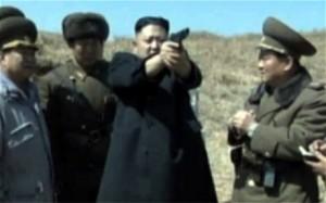 Kim Jung Un firing a handgun on one of the propaganda videos in North Korea