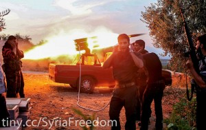 Syrian rebels firing missiles at government soldiers photo FreedomHouse via Flickr