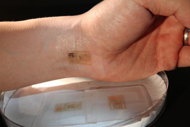 electronic chip wrist skin password motorola Univ Illinois