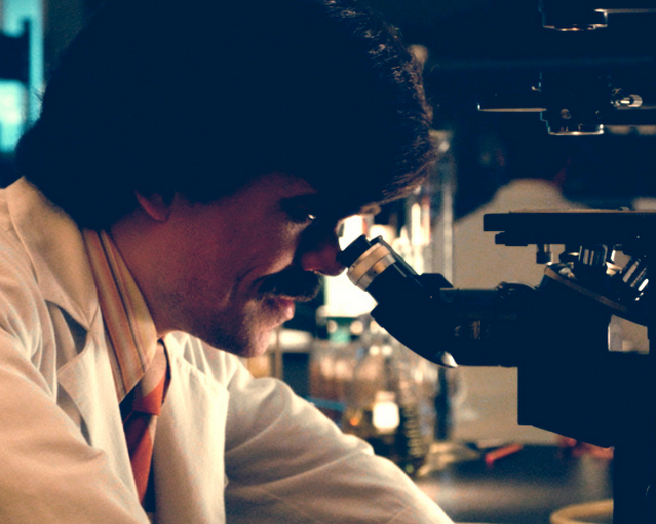 Peter Dinklage Trask at microscope