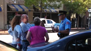 police officer meeting with group attempting to feed homeless
