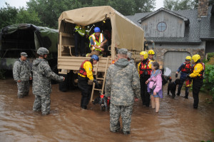 National Guardsmen respond to floods in Boulder County, Colo., Sept.12, 2013. The Guard is working with local agencies to help people in the area affected by the flooding by evacuating people using high-clearance vehicles. (Army National Guard Photo by Sgt. Joseph K. VonNida/Released)