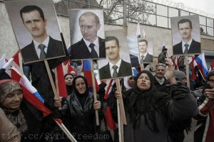 Syrians hold photos of Assad and Putin during a pro-regime protest in front of the Russian embassy in Damascus, Syria, Sunday, March 4, 2012. Flickr FreedomHouse