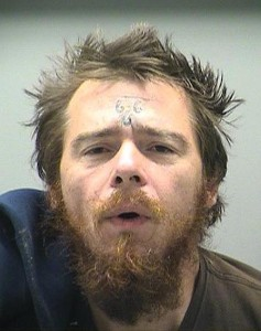 Gregory Clark - tattoo on forehead?