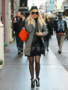 British singer-songwriter and actress Rita Ora is seen braving the cold out in NYC, opting for stockings, a wool coat and a long sweater. She did bring a hat though, on October 23, 2013. photo: Splash Page
