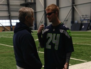 Coach Pete Carroll meeting with Jake Olson