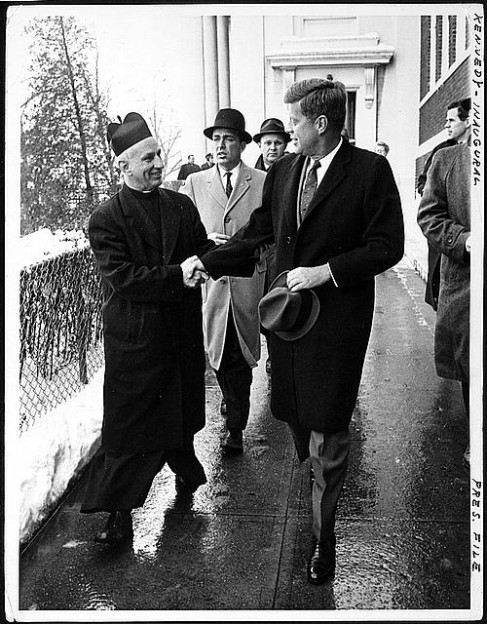 President-elect John F. Kennedy shakes hands with Father Richard J. Casey, the Pastor, after attending Mass at Holy Trinity Church ... prior to inauguration ceremonies, January 20, 1961. Library of Congress.