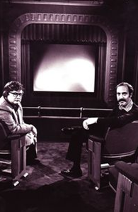 """Roger Ebert described this photo: """"Our first """"Sneak Previews"""" set: Not a very wide screen, and the fake rail supports are painted pop bottles"""""""