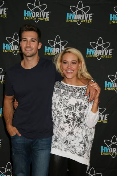 Big Time Rush Lead Singer Jason Maslow and his dance partner blond bombshell Peta Murgatroyd cozy up backstage before the premiere of Dancing with the Stars. These two pose intimately despite James's denial of the rumors that these two are partners beyond the dance floor. photo courtesy HYDRIVE Energy Water