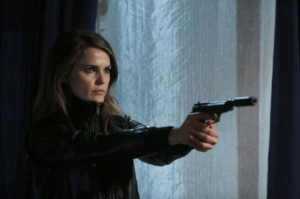 Keri Russell as Elizabeth with gun the Americans season 2 photo
