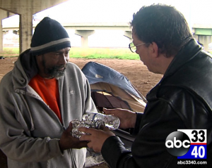 Pastor Rick Wood feeding the homeless  photo screenshot from ABC coverage