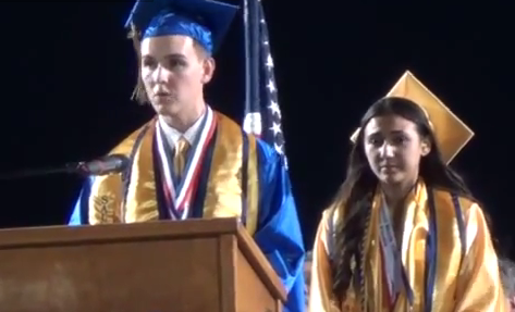 Brooks Hamby delivering graduation speech, including references to God and Jesus Christ  photo/screenshot YouTube