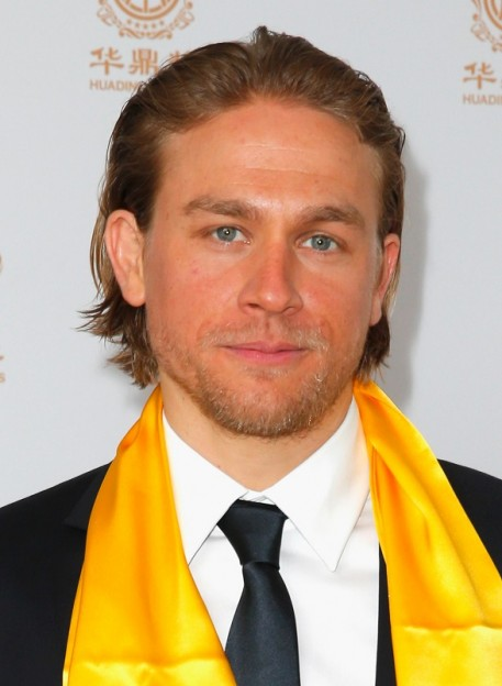 Actor Charlie Hunnam poses with the award for Best Global Emerging Actor in the press room during the Huading Film Awards on June 1, 2014 at Ricardo Montalban Theatre in Los Angeles, California. Huading Film Awards is China's #1 Film awards, in the U.S. for the first time. (Photo by Joe Scarnici/Getty Images for Huading Film Awards)