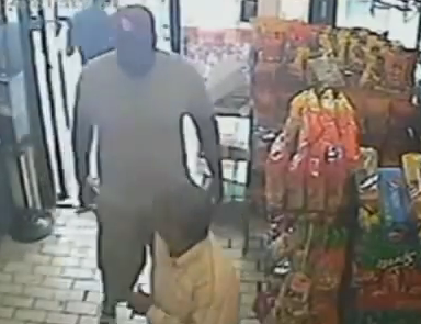Michael Brown robbing a store minutes before being fatally killed by police  photo/screenshot of video