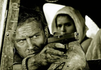 Tom Hardy Mad Max with gun Mad Max Fury Road photo