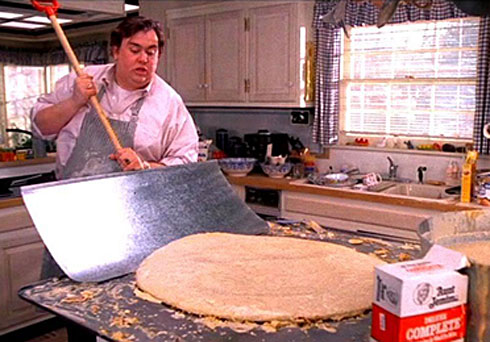 John Candy as Uncle Buck making giant pancakes