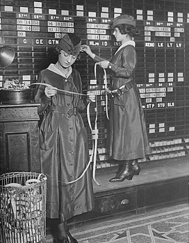 The Waldorf-Astoria Hotel is employing girls to operate tickers and stock exchange boards.  photo/1918 US War Dept - public domain