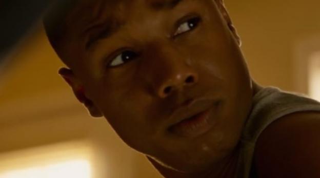 Michael B Jordan as Johnny Storm in The Fantastic Four