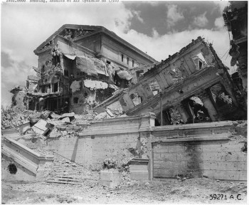 Complete demolition of the Legislature Building in Manila, P.I. One of the finest government buildings in the Far East, it was the pride of the Philippine Government. Filipino citizens pass the building and look in abject wonderment at the results of total war.  photo/ Department of Defense. Department of the Army. Fort Leavenworth, Kansas 1945