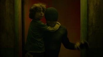 Charlie Cox saving child in Netflix series Daredevil