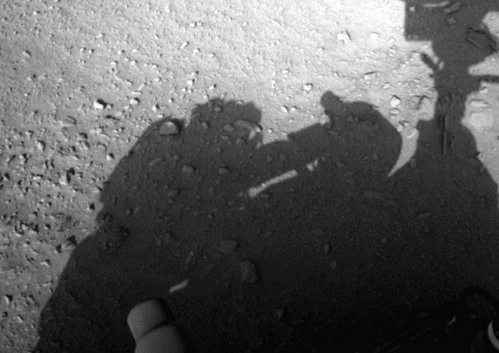 Curiosity Rover casting a shadow. Conspiracy theorists, on the other hand, have pointed out that the shadow near the left-hand side of the picture is clearly a technician, working on the rover in some way, shape or form. photo/ NASA