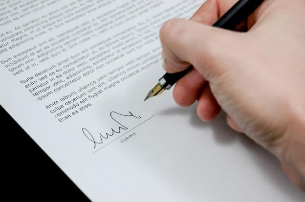 hand writing signing a document photo/ Michael Jarmoluk via pixabay.com