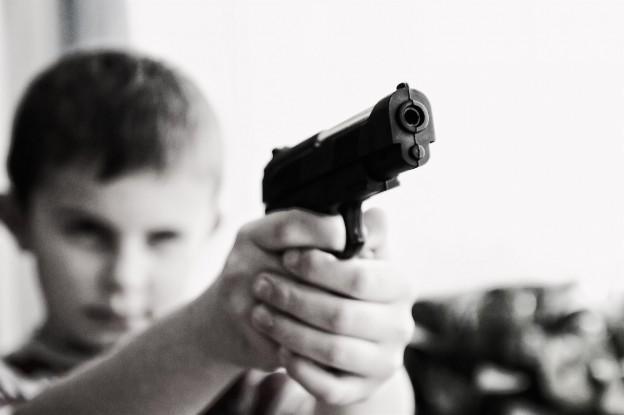 kid pointing handgun photo/ Michael Jarmoluk via pixabay.com