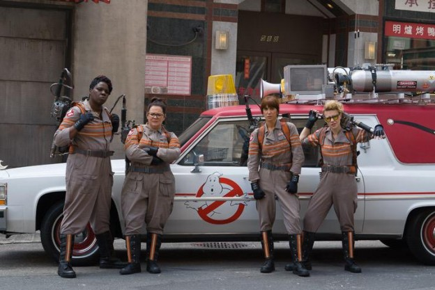 Ghostbusters cast photo in front of Ecto 1