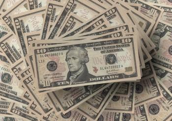 dollar-ten dollar bills pile by Gerd Altman via pixabay