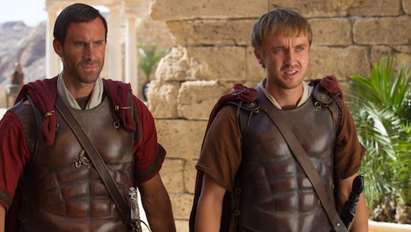Clavius (Joseph Fiennes) and Lucius (Tom Felton) leave Pilate's Palace to look at another corpse that may be Yeshua.