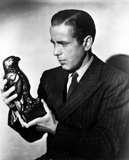 Humphrey Bogart as Sam Spade, holding the Maltese Falcon.