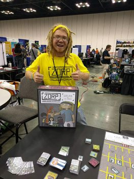 Carl Sommer, founder of Wonky Rhino Games and creator of ZORP (Zombie Oblivion Response Pack) shows off his creation at a gaming convention in Indianapolis. (Photo provided by Carl Sommer)