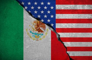 mexico flag on broken brick wall and half usa united states of america flag